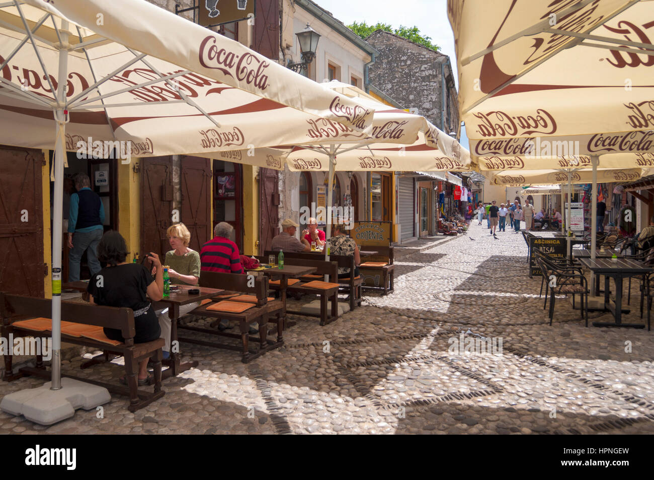 Old town Mostar cafes and tourists, Bosnia Herzegovina - Stock Image