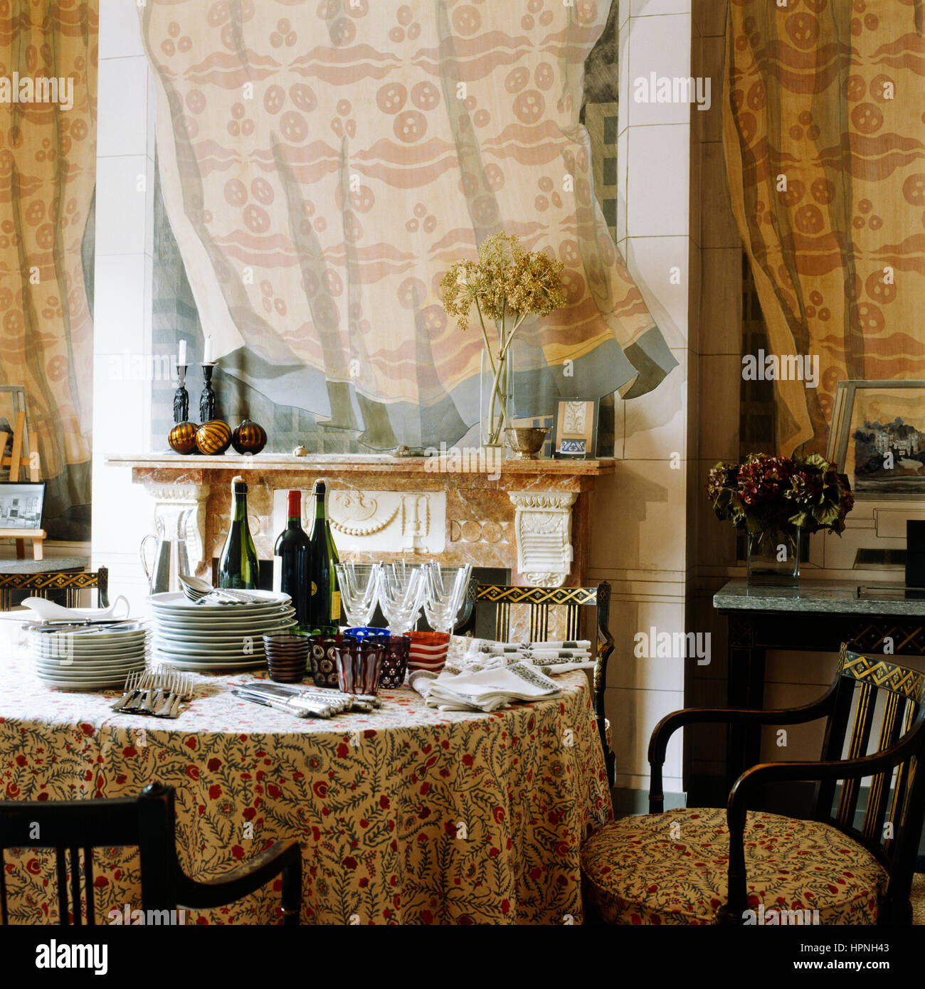 A dining room with a fireplace. - Stock Image