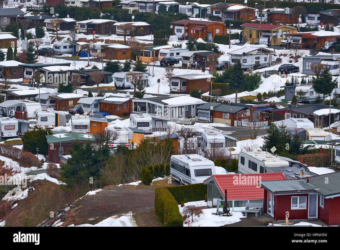 WINTERBERG, GERMANY - FEBRUARY 16, 2017: Aerial view of a snow covered trailer park at Ski Carousel Winterberg Stock Photo