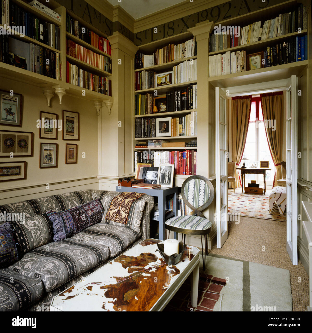 A living room with bookshelves. - Stock Image