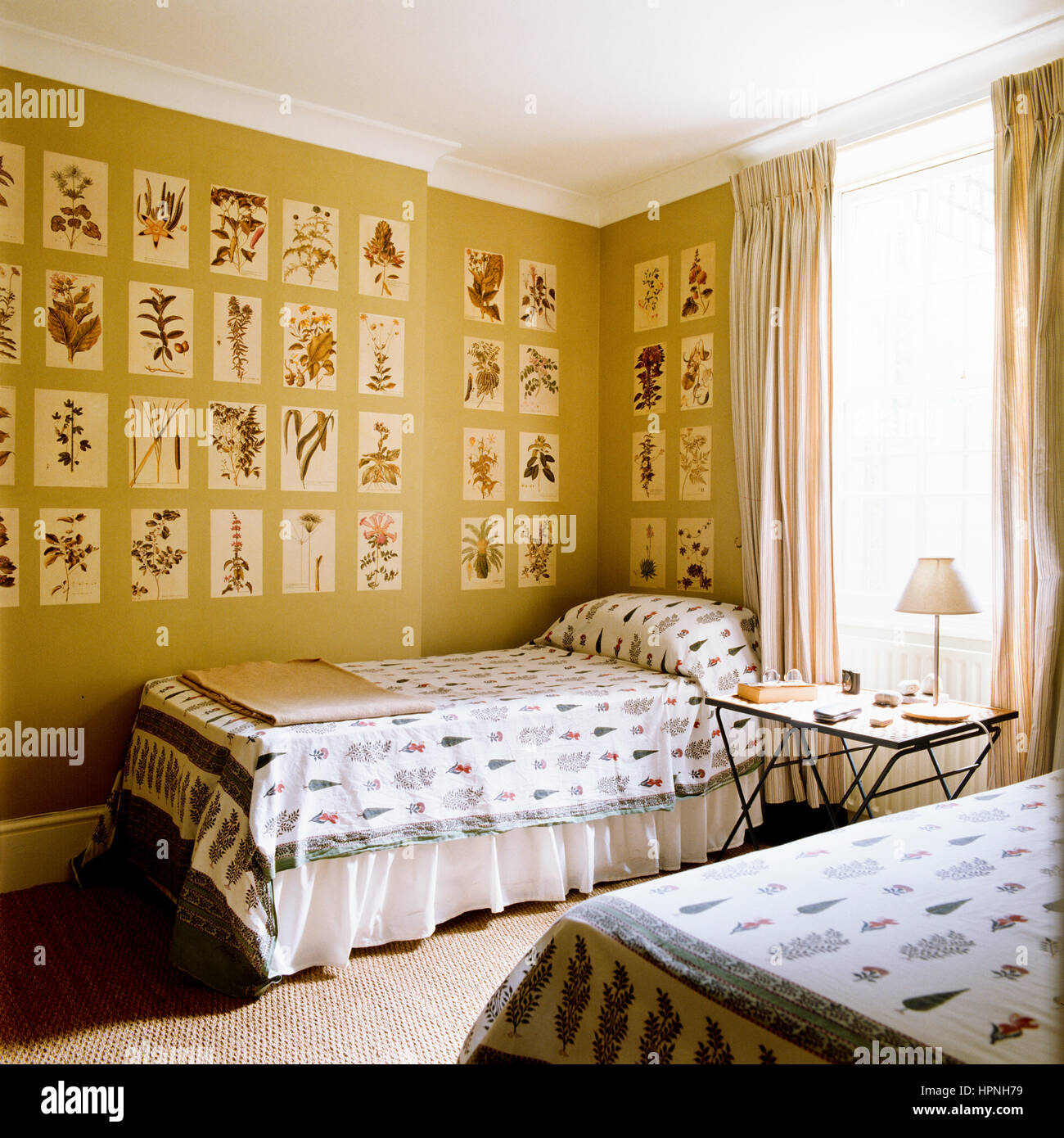 A bedroom with two beds and a bedside table Stock Photo: 134469533 ...