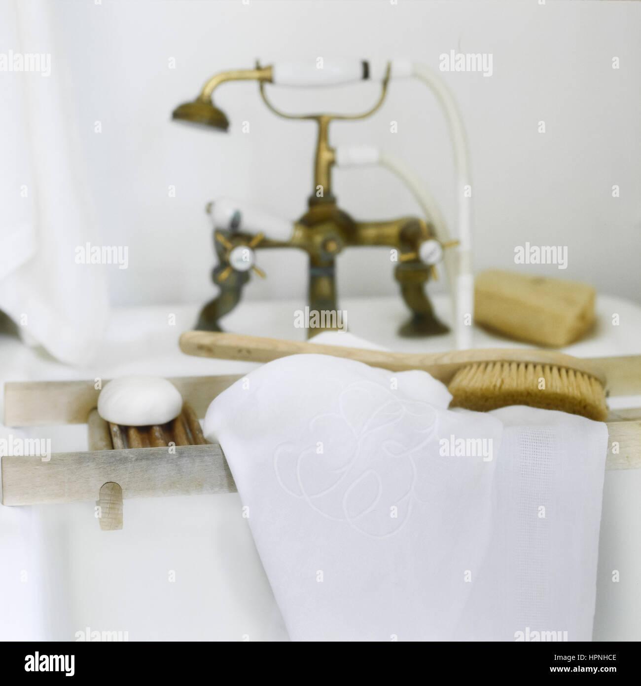 Toiletries on a bathtub rack. Stock Photo