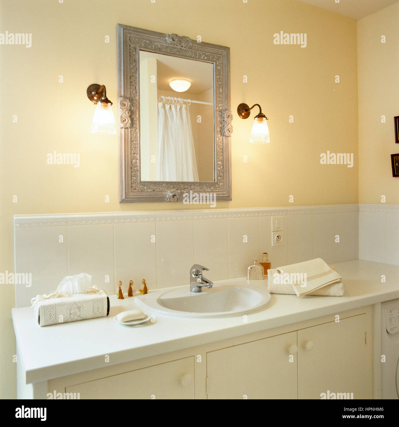 A bathroom sink with a mirror. - Stock Image