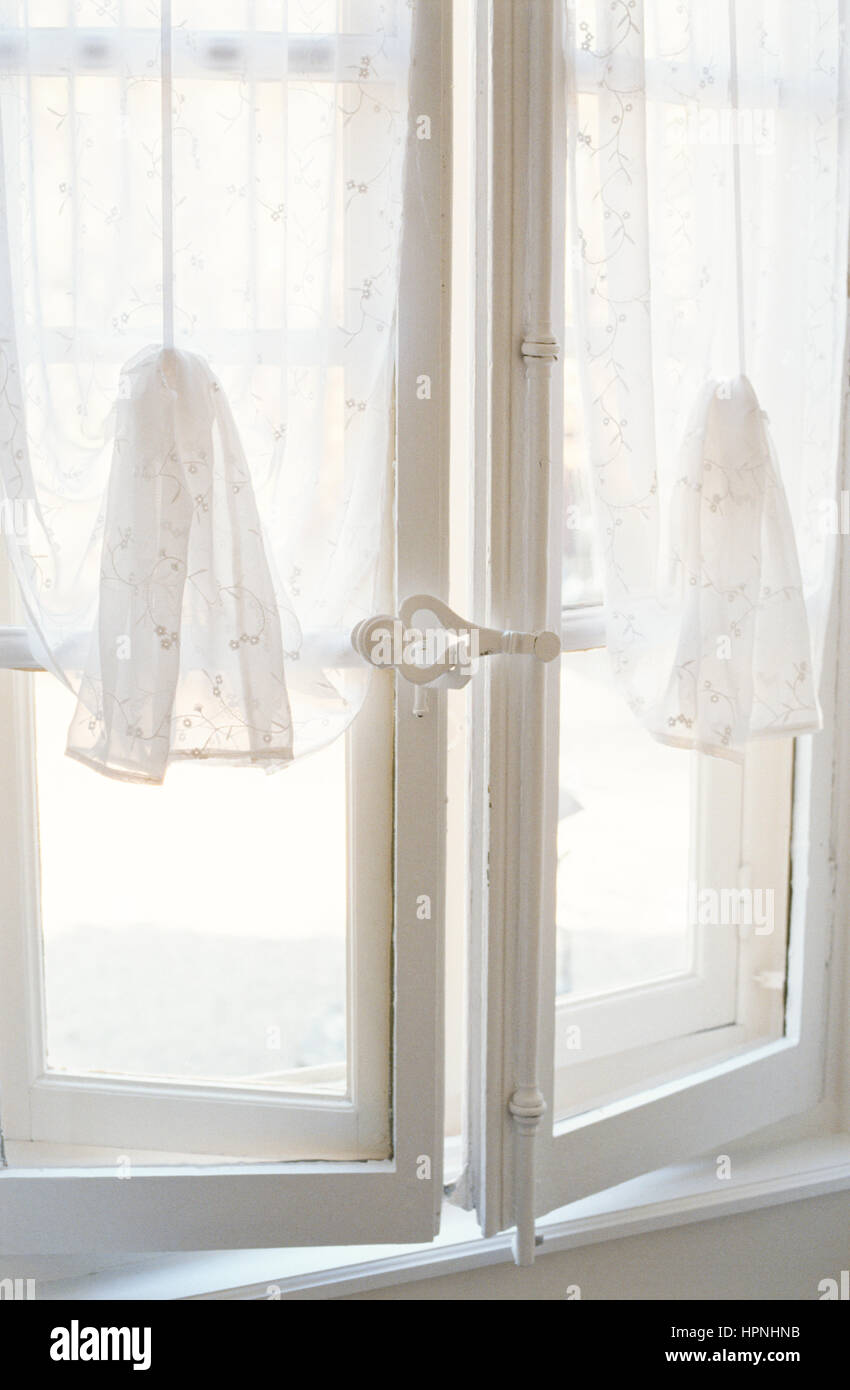 White net curtains on a window. - Stock Image