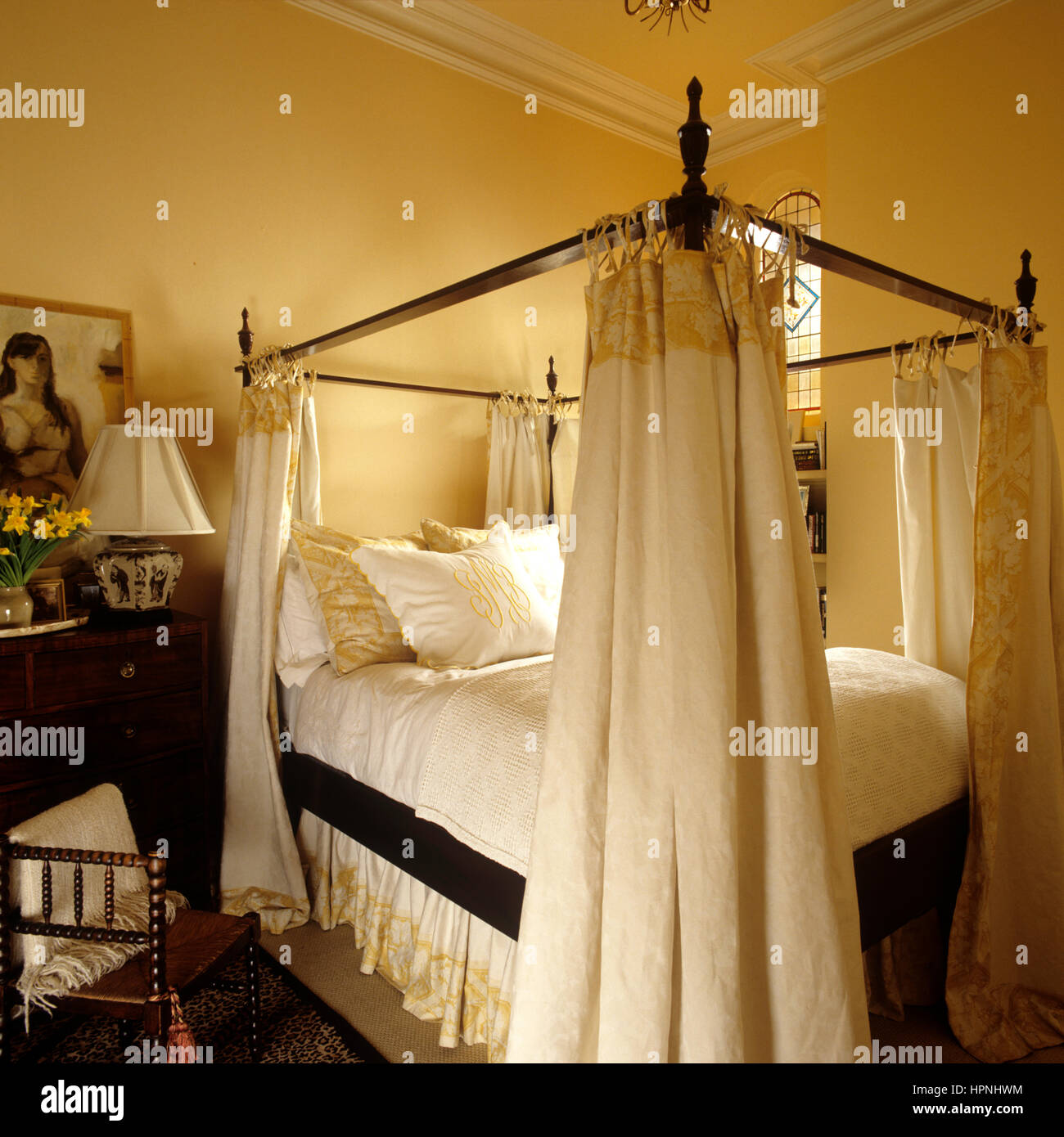 A four poster bed. - Stock Image