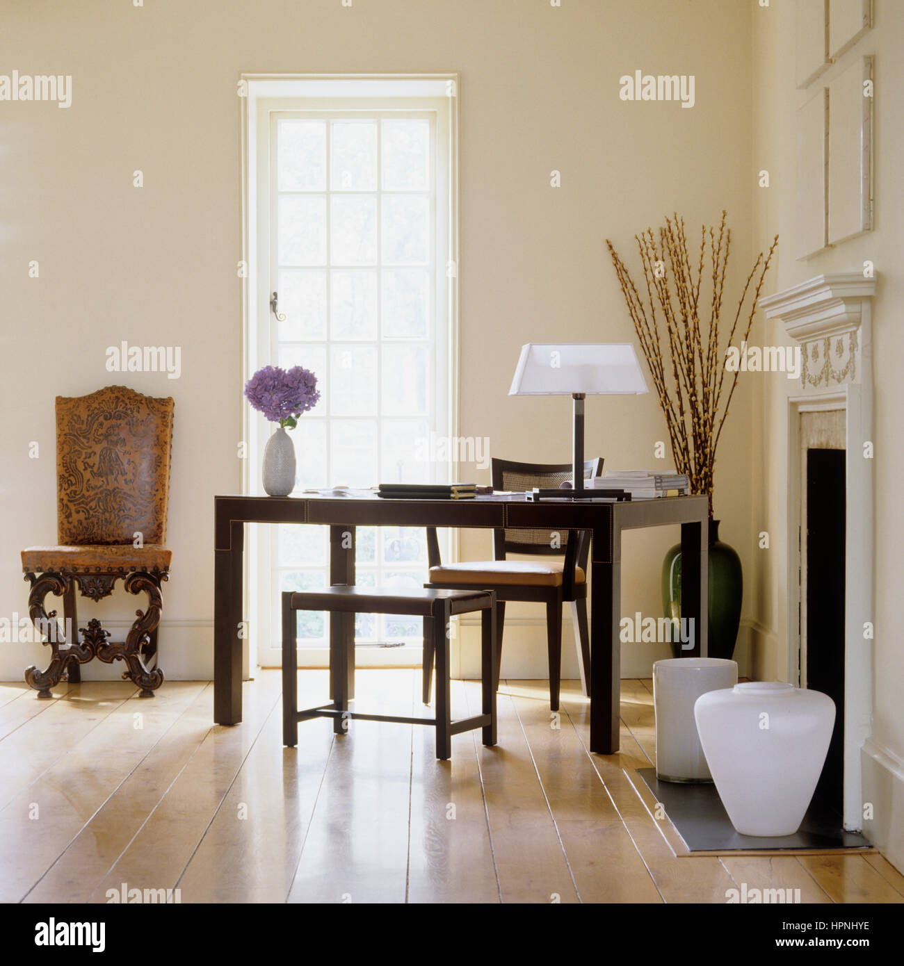 A study by a fireplace. - Stock Image