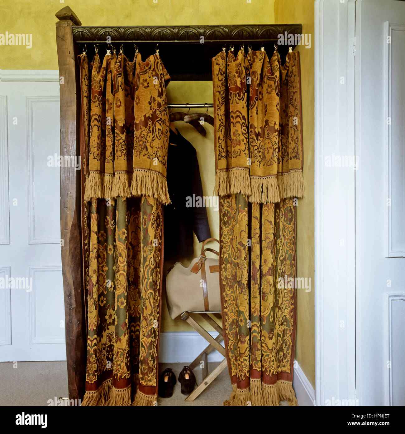 A closet with curtains. - Stock Image