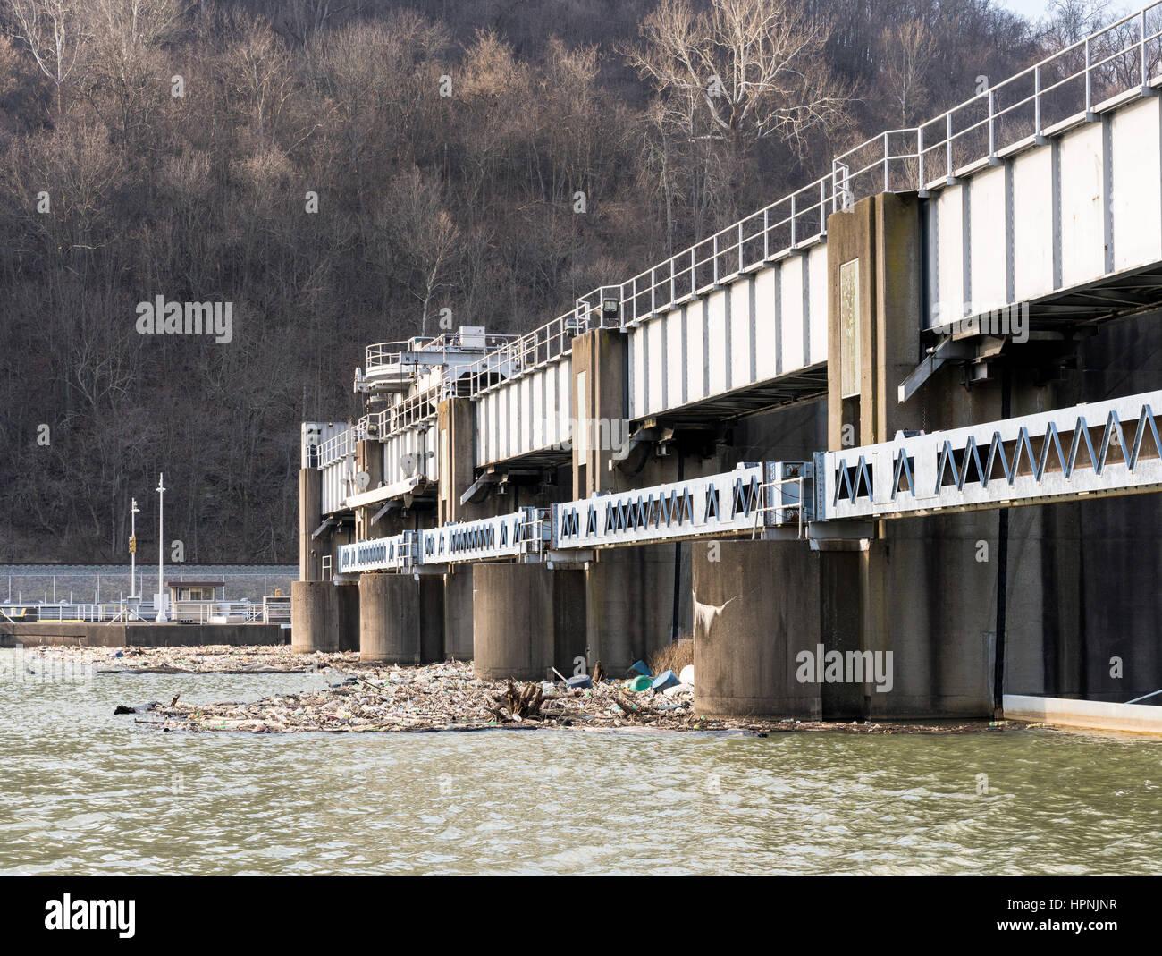 Lock or dam sluice gates on River Monongahela in Morgantown West Virginia with collected trash - Stock Image
