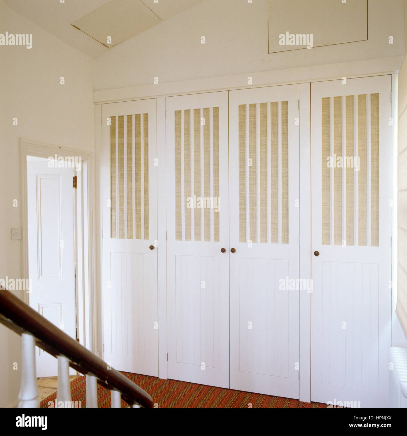 A closet by a railing. - Stock Image