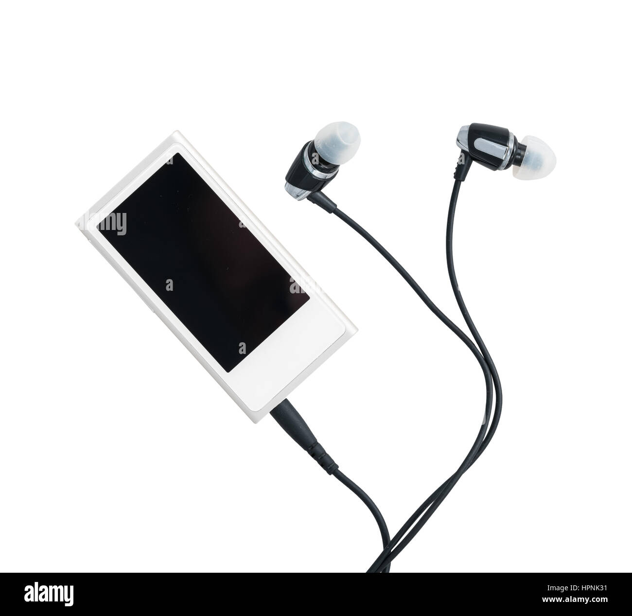 Small white portable MP3 digital music player with earbuds isolated against a white background - Stock Image
