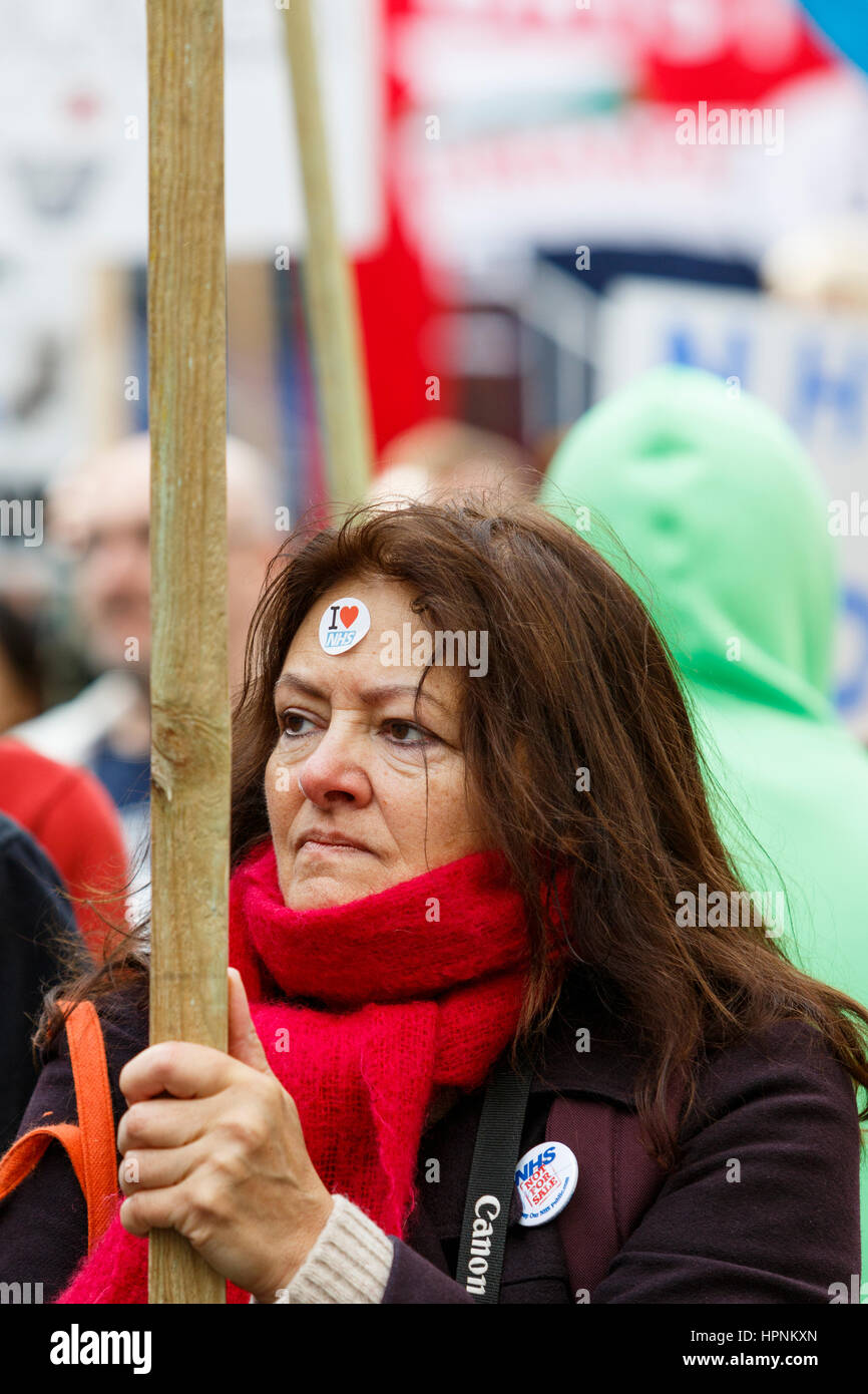 NHS Protesters carrying placards and signs are pictured as they take part in a save our NHS protest march and demonstration Stock Photo