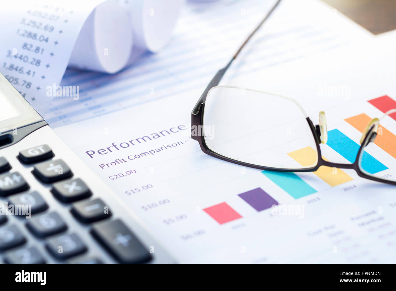 Business performance analysis with colorful bar graph and calculator business performance analysis with colorful bar graph and calculator ccuart Image collections