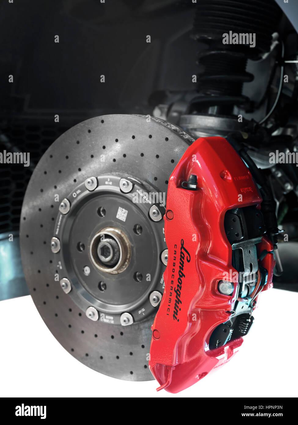 Closeup of Lamborghini sports car front ceramic brakes, a disc and a caliper - Stock Image