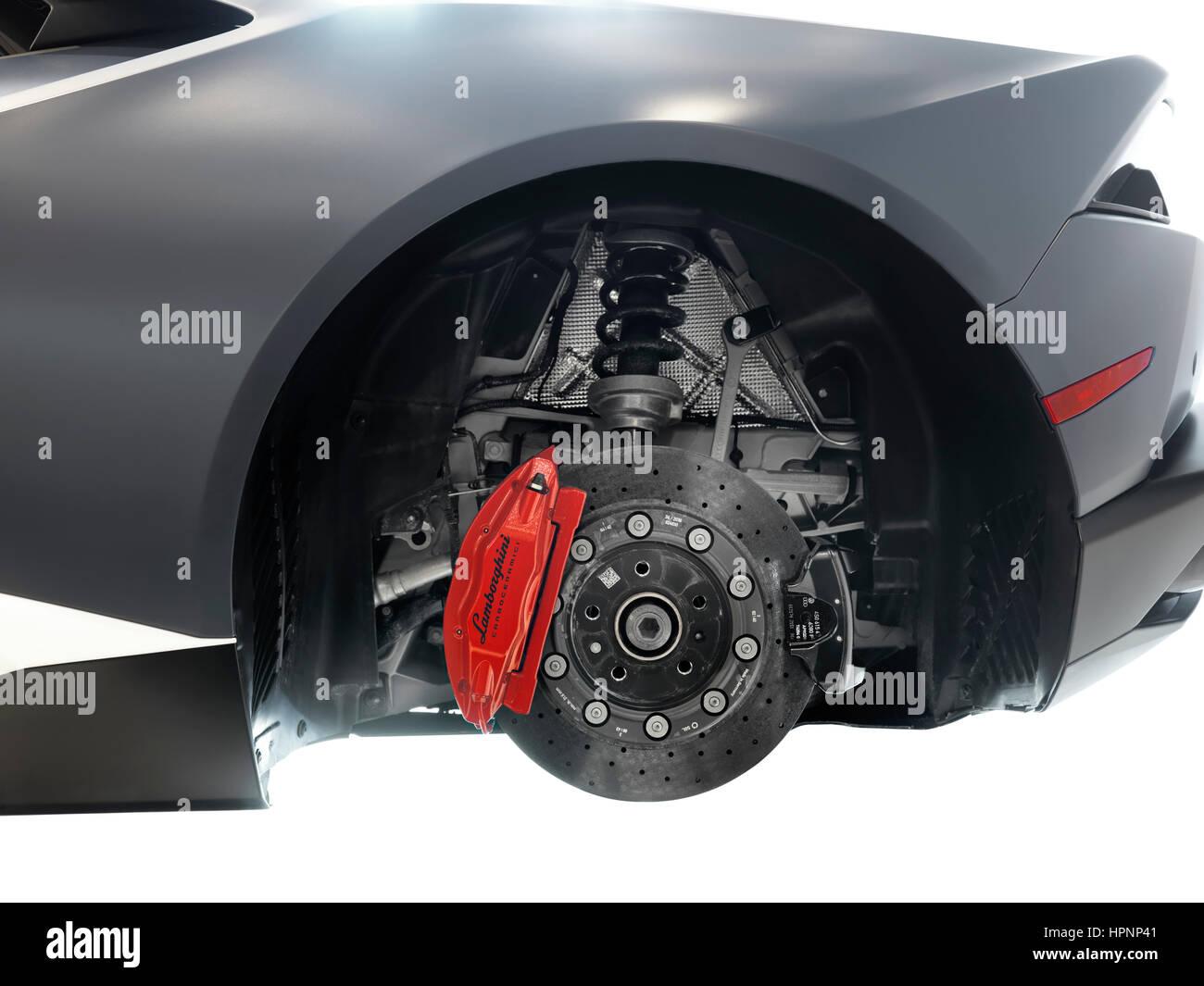 Closeup of Lamborghini sports car performance ceramic brakes, a disc and a caliper - Stock Image