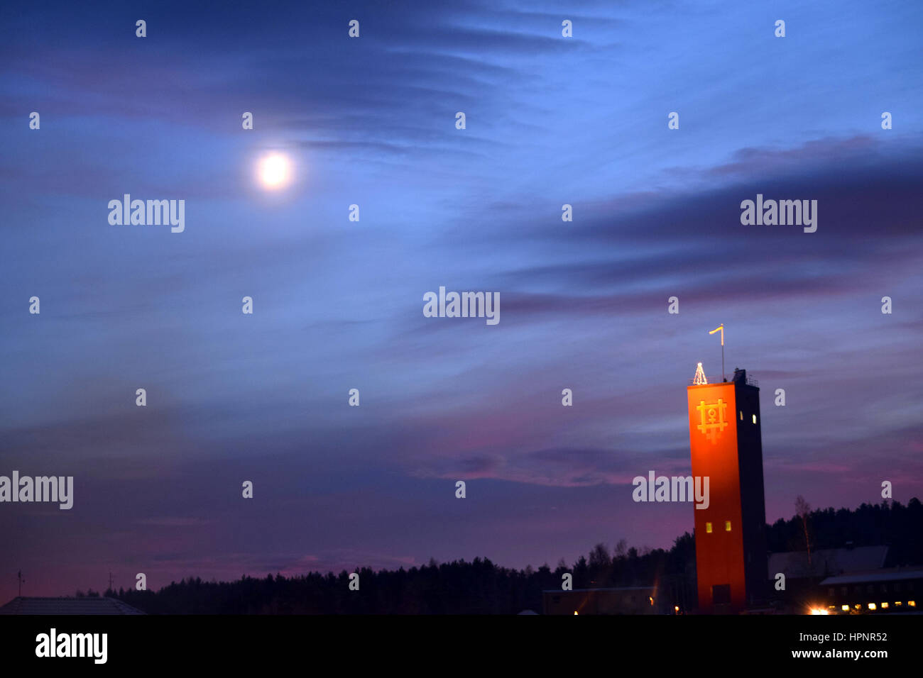 A christmas tree on the tower in the moonshine. - Stock Image