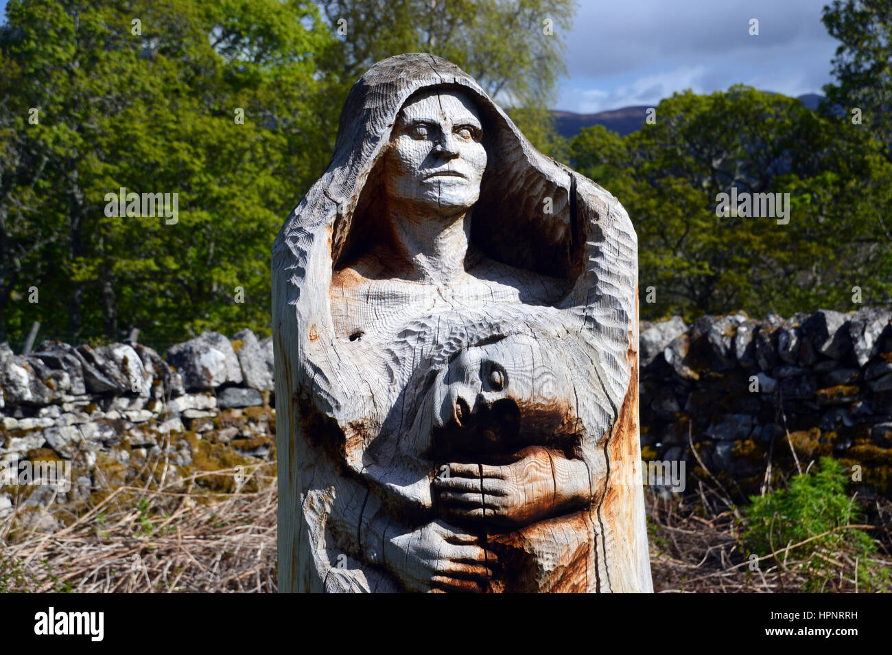 Wooden Tree Sculpture called Third World part of the Frank Bruce Sculpture Trail, Inshriach Forest, Feshiebridge,Cairngorms - Stock Image