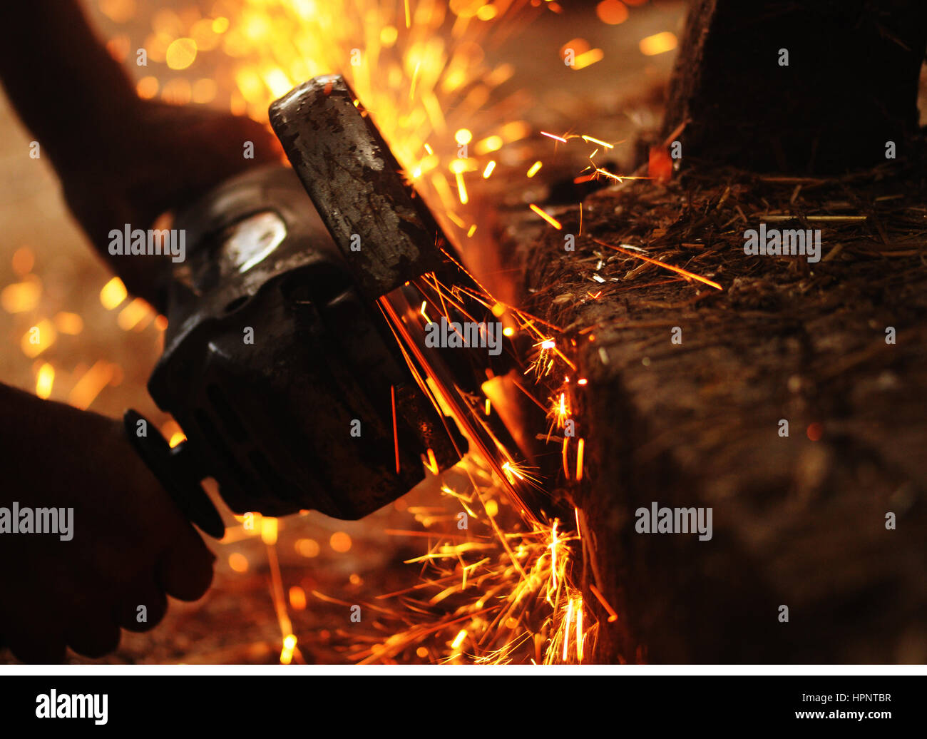 Angle grinder working with sparks flying - Stock Image