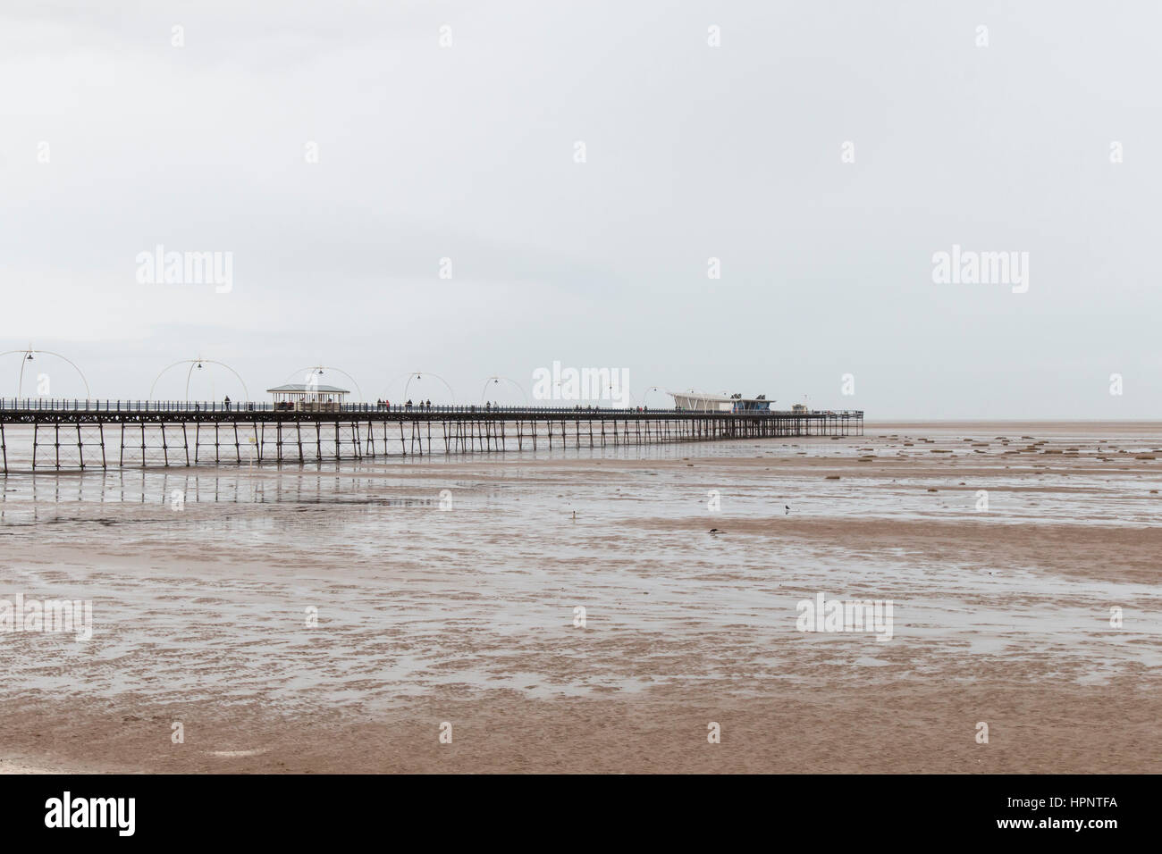 Southport Pier on the sea front, during an un-seasonally warm February day. 22/02/17. - Stock Image