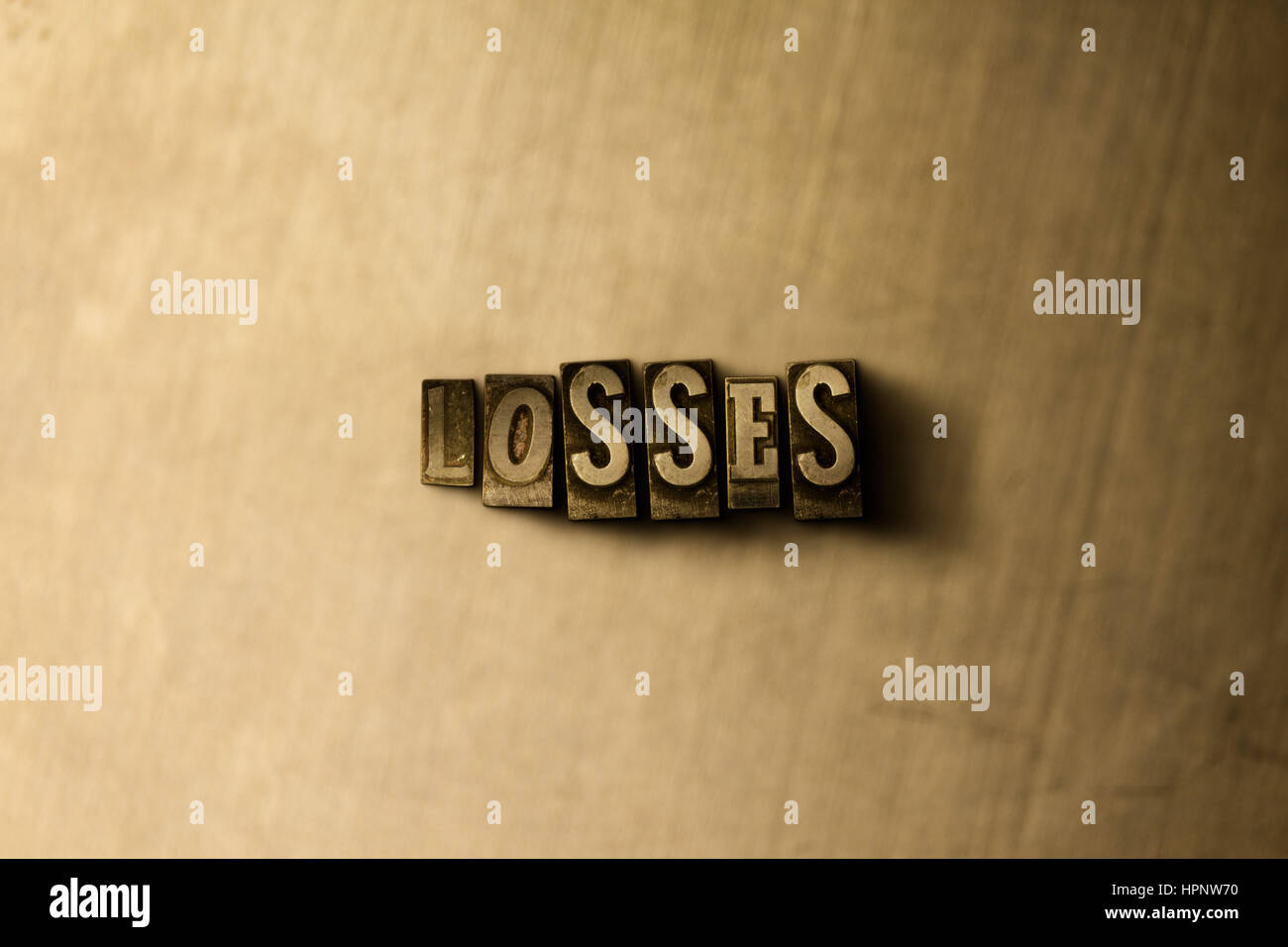LOSSES - close-up of grungy vintage typeset word on metal backdrop. Royalty free stock illustration.  Can be used - Stock Image
