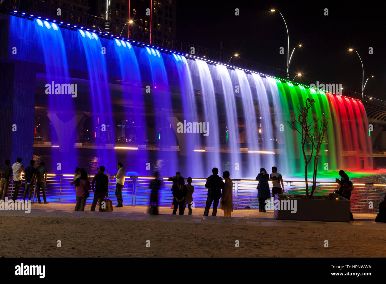 DUBAI, UAE - NOV 28, 2016: Colorful illuminated Waterfall in Dubai. The Waterfall is part of the Dubai Water Canal - Stock Image