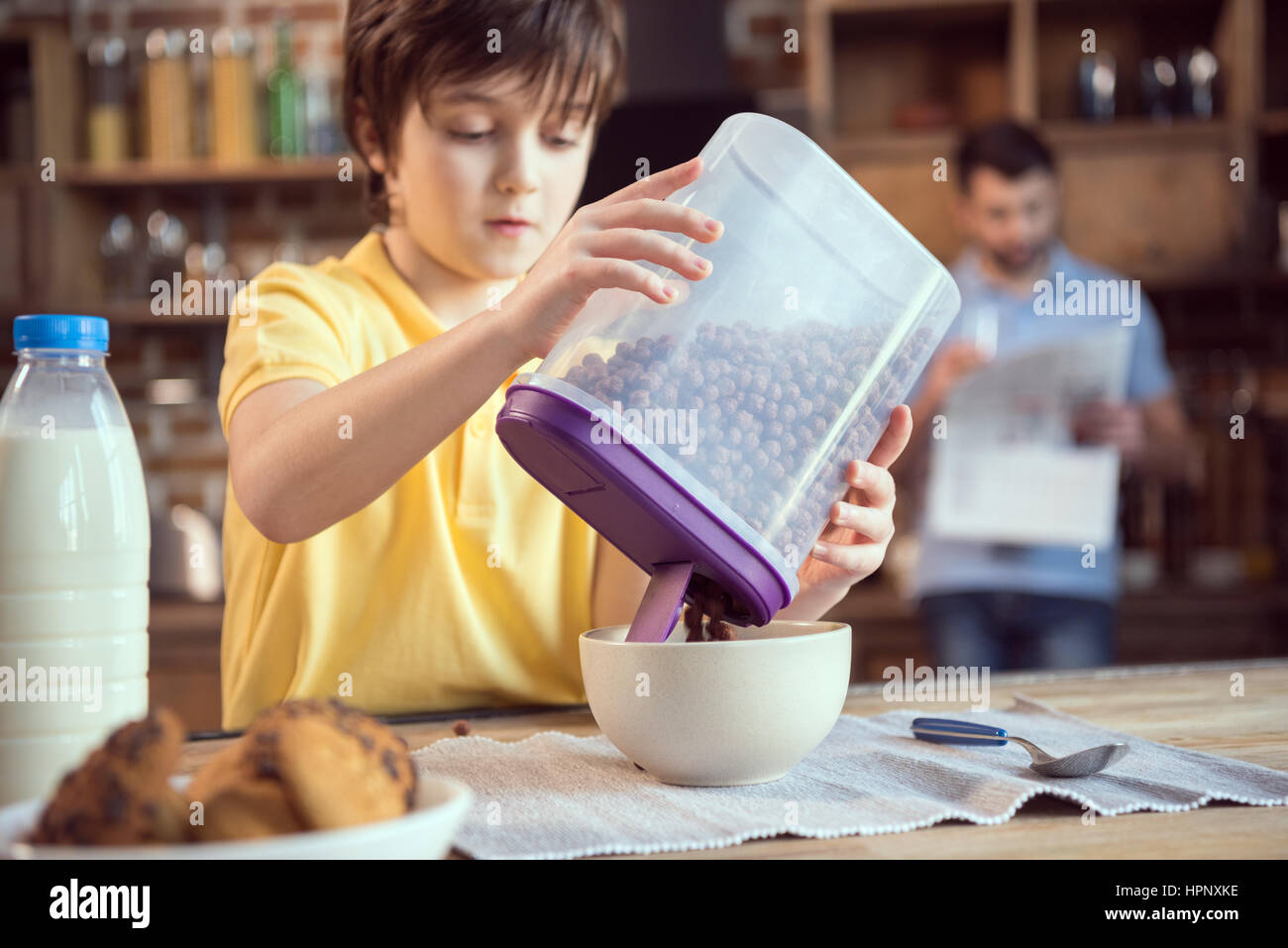 little boy holding chocolate balls for breakfast - Stock Image