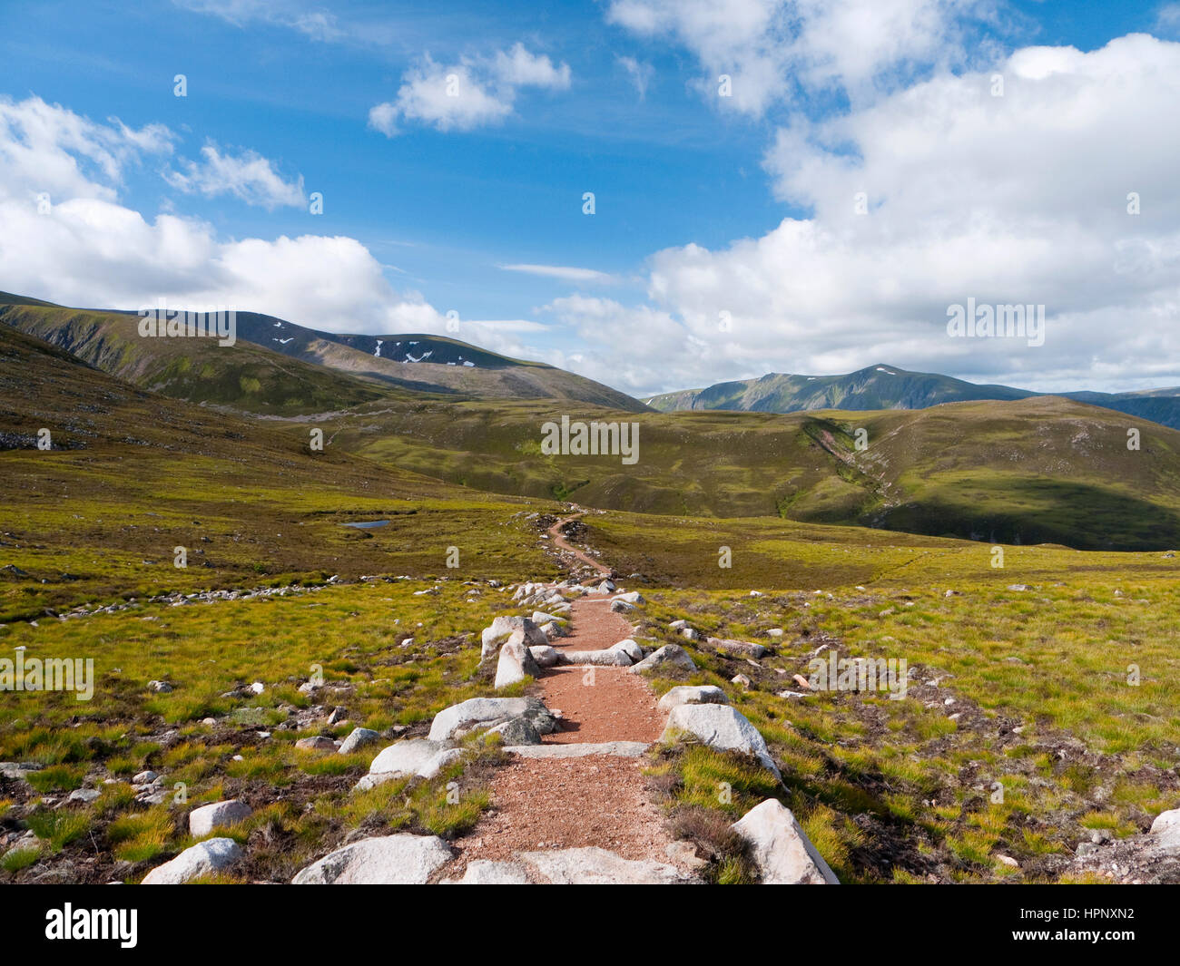 Well maintained path across moorland on the Rothiemurchus estate in the Cairngorms. Braeriach rises to the left - Stock Image