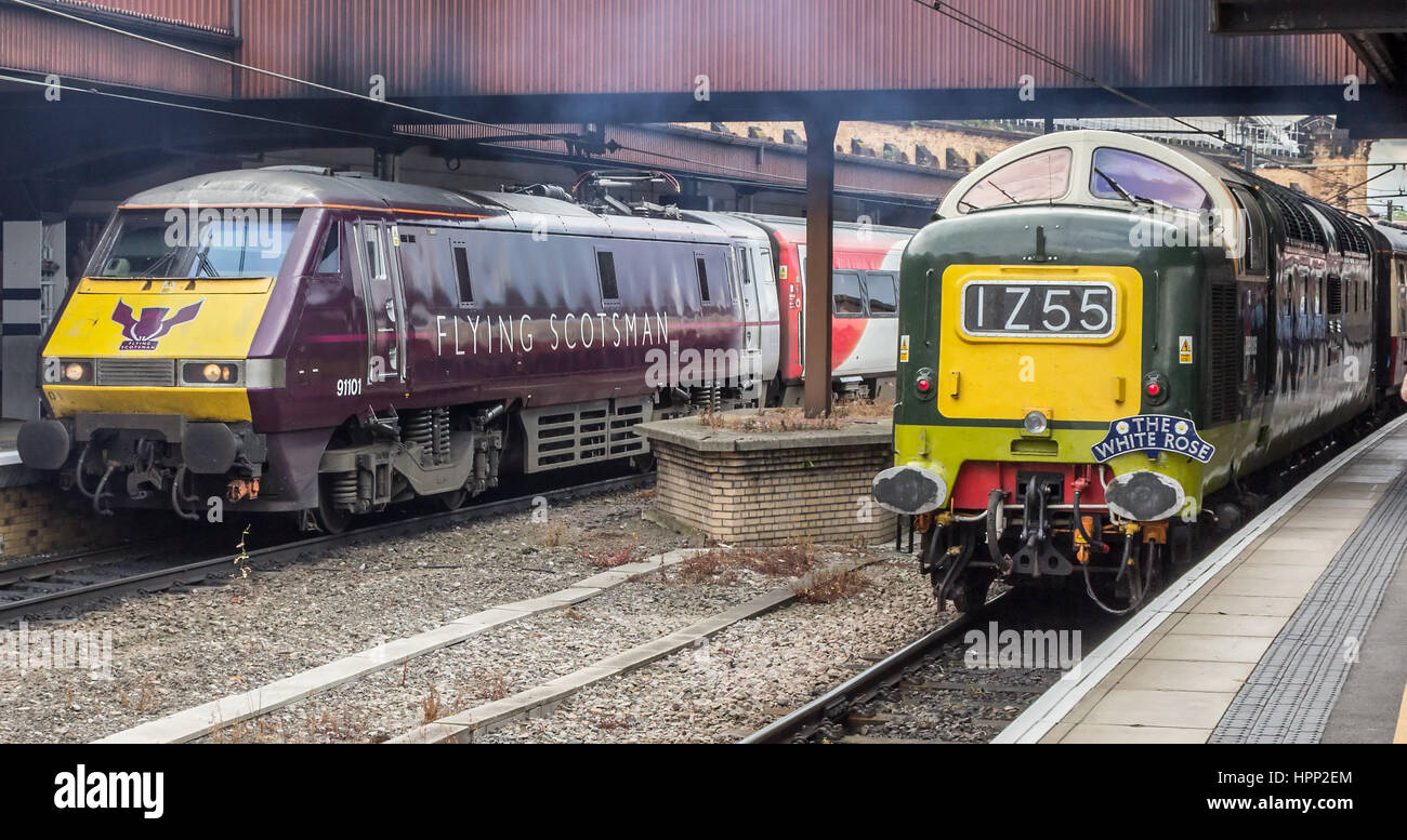 Class 91 Electric train 91101 Flying Scotsman stands beside preserved class 55 Type 5 Deltic diesel D9009 Alycidon Stock Photo