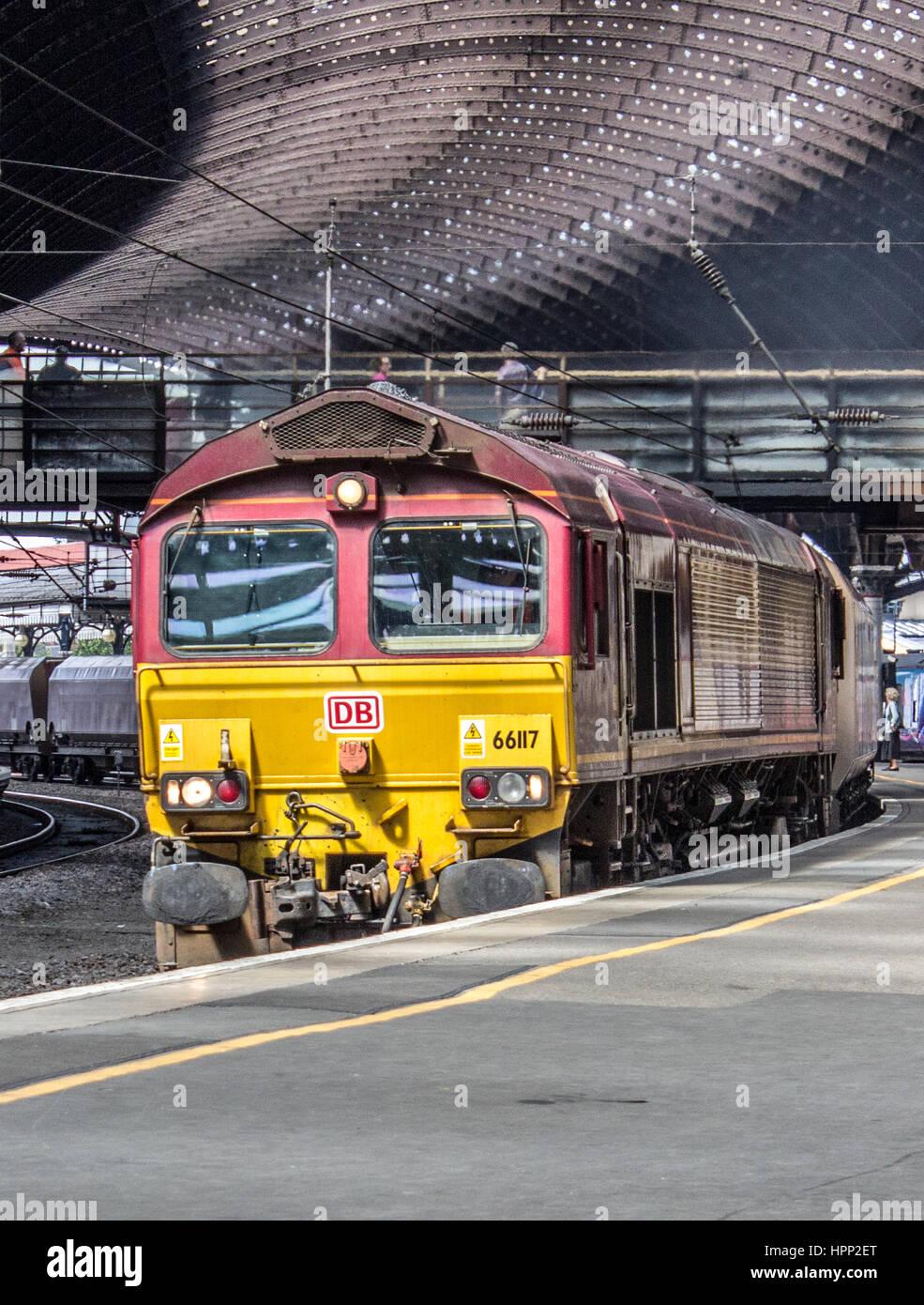 Class 66 Frieght Diesel Locomotive Train passing through York Station - Stock Image