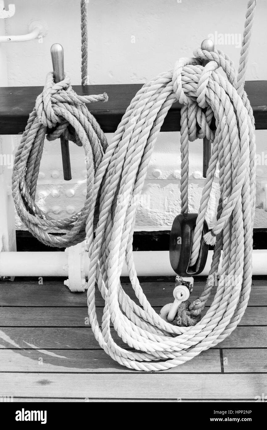 Ropes Tied To Metals On Railing In Boat Stock Photo