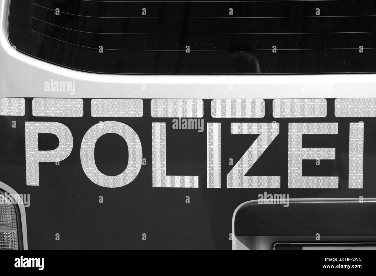 Back of german police car. Black and white image Stock Photo