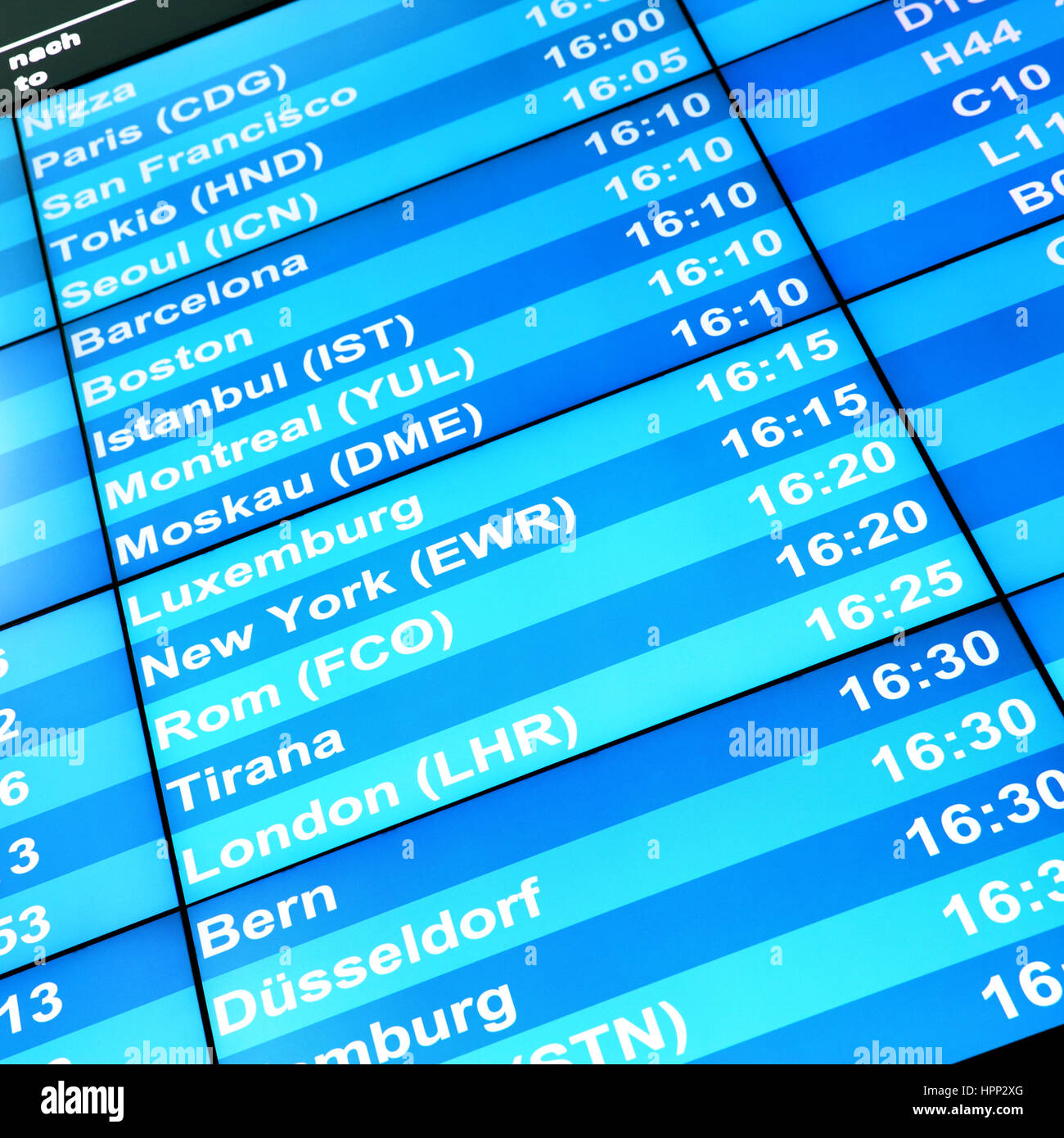 Modern flight information board in an airport - Stock Image