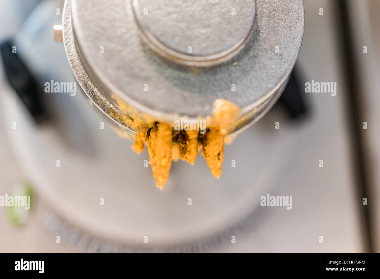 Leftover peanut butter on machine grinder Stock Photo