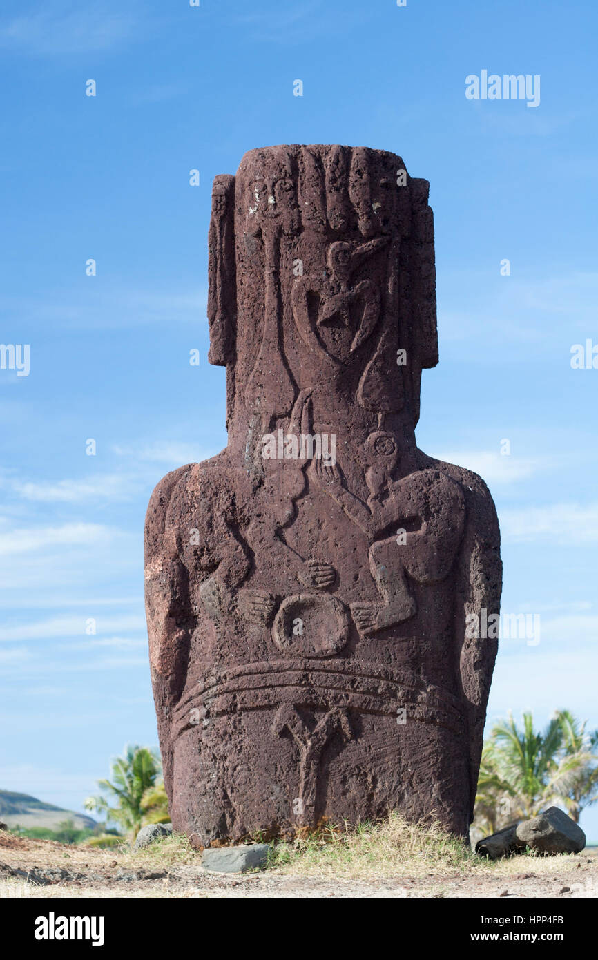 Easter island moai with birdman petroglyphs carved on the back stock