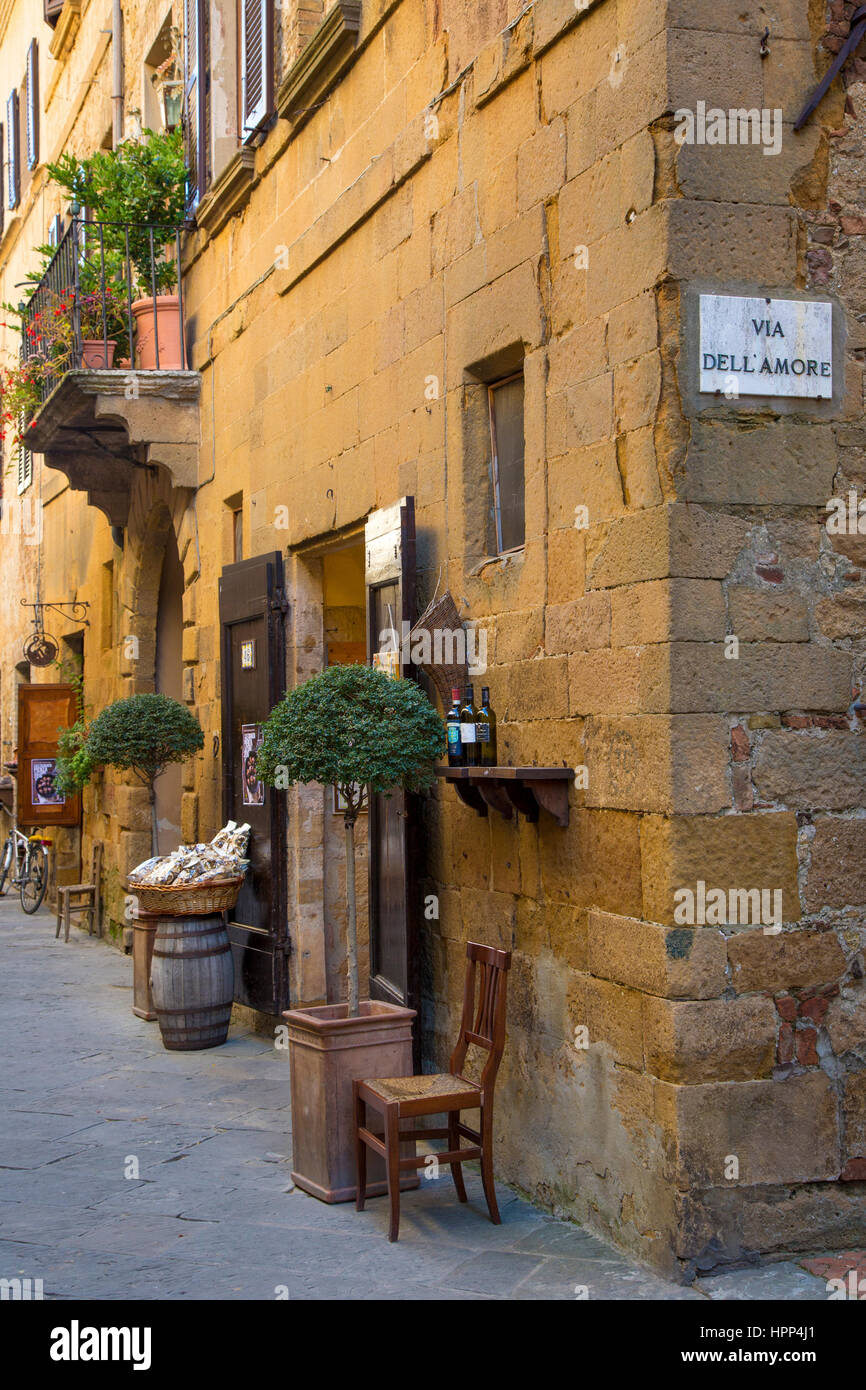 Street corner with Via Dell Amore road sign in Medieval town of Pienza, Tuscany, Italy - Stock Image
