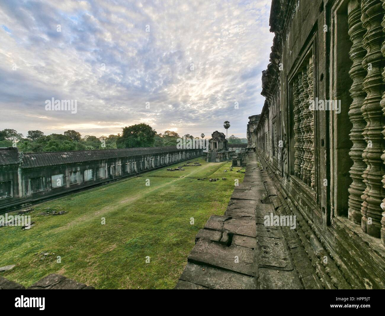 Sunset over inner courtyard at temple ruin angkor wat - Stock Image