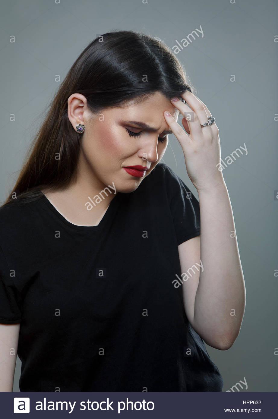 Sad Depressed Girl with Headache - Stock Image