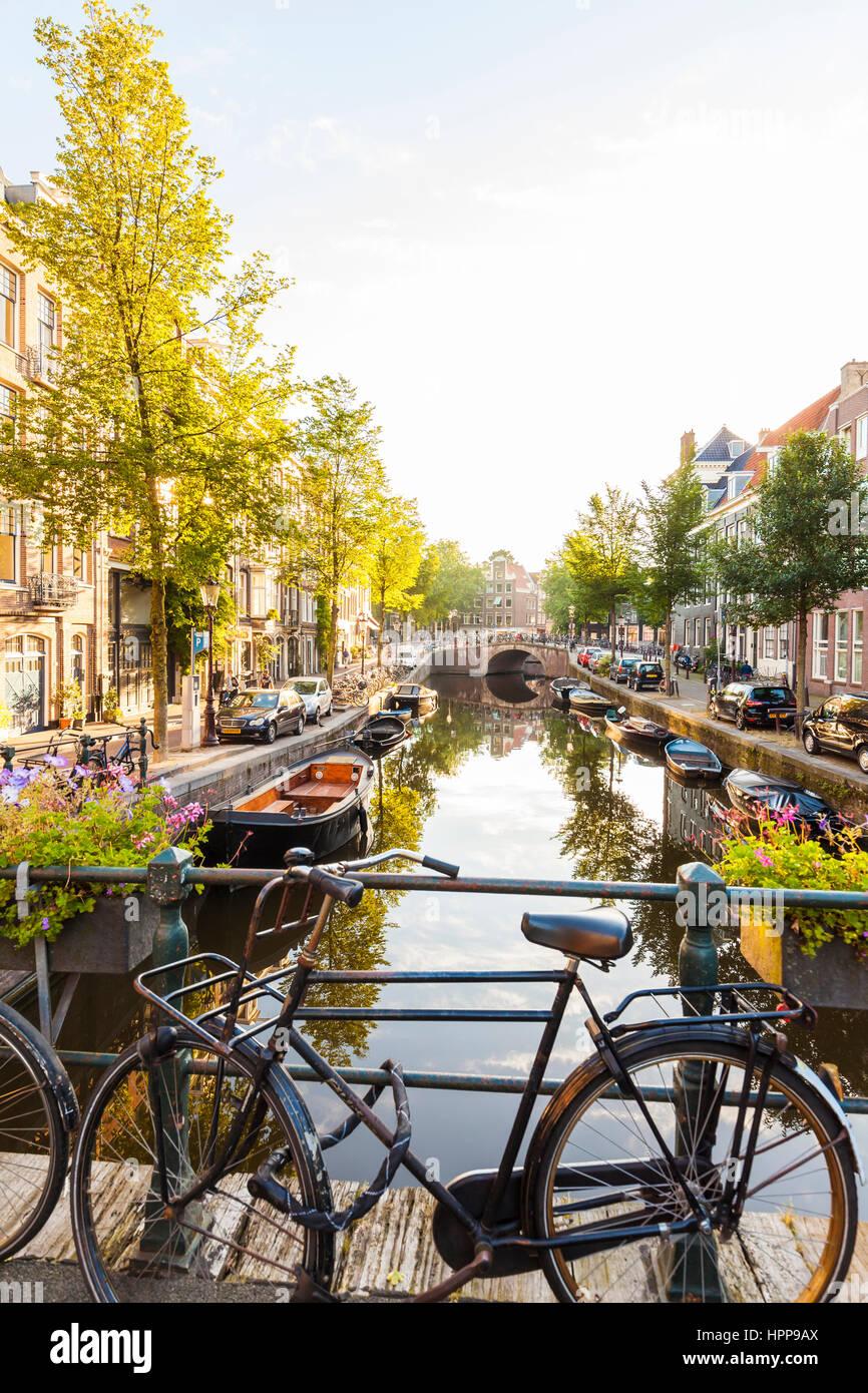 Netherlands, Amsterdam, parked Dutch roadster on bridge - Stock Image