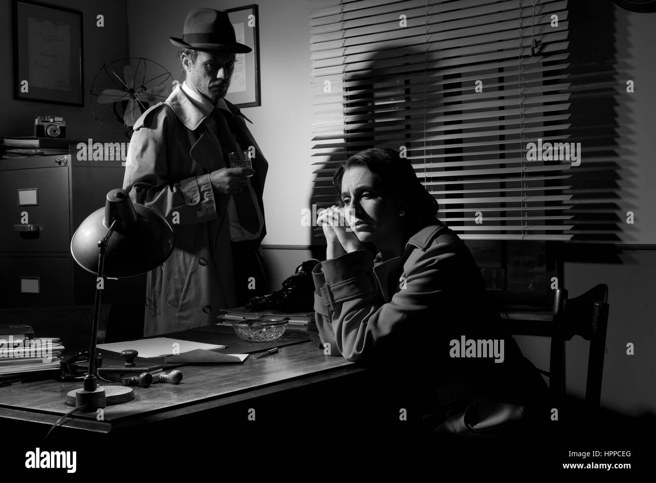 detective interviewing a young sad woman in his office