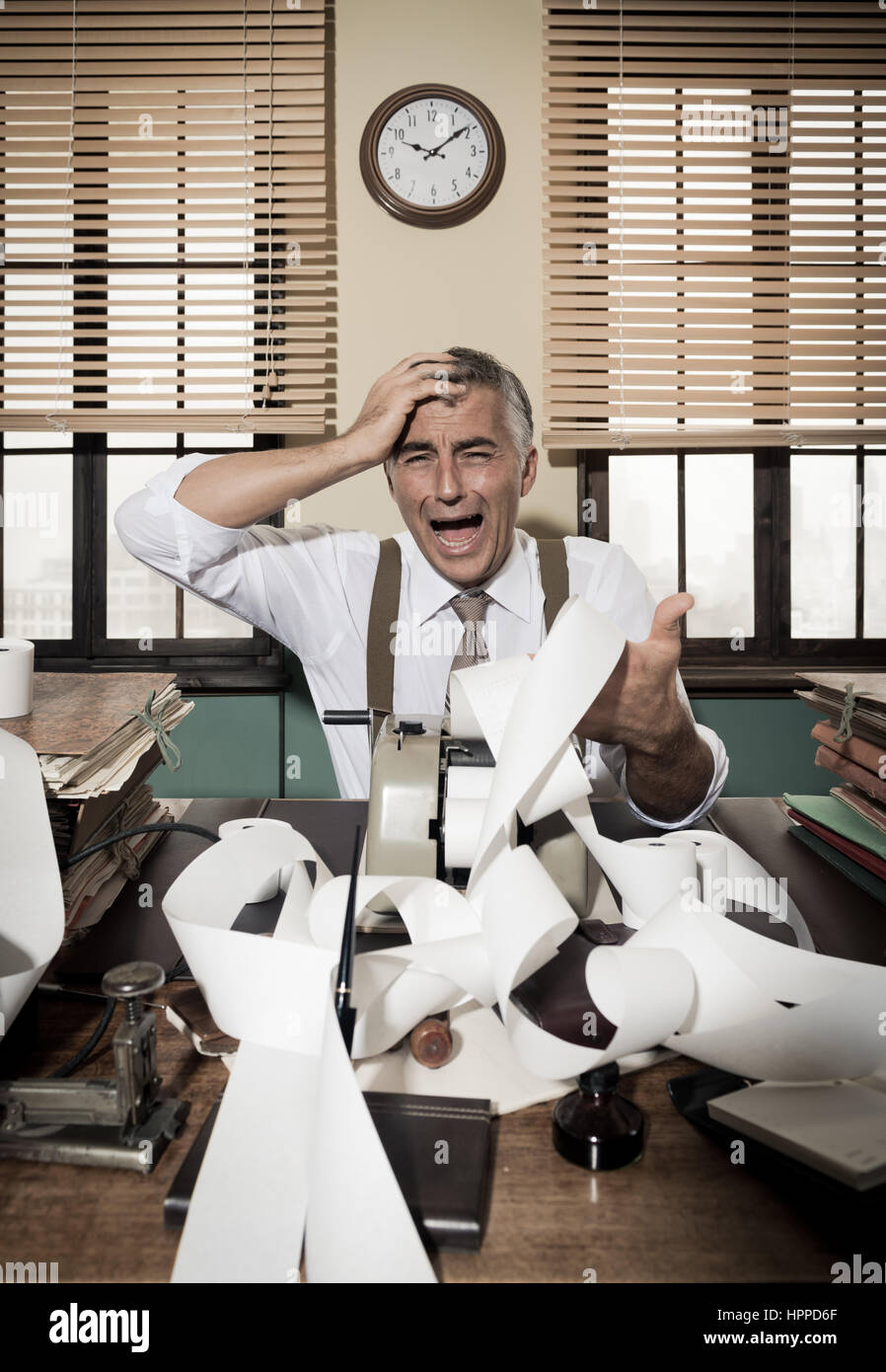 Vintage accountant checking errors on long bills on cash