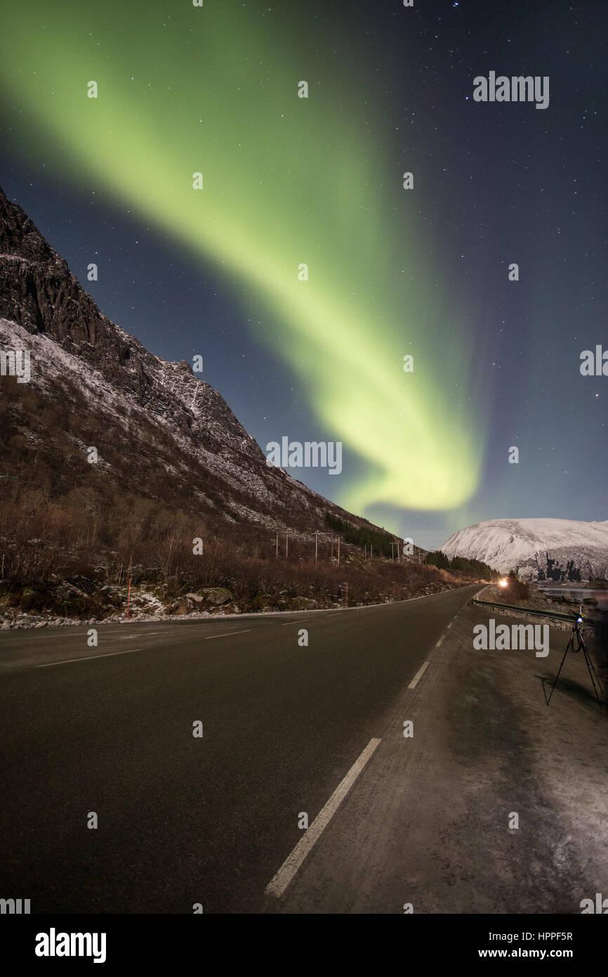 Aurora over road E10 , Lofoten Islands, Norway - Stock Image