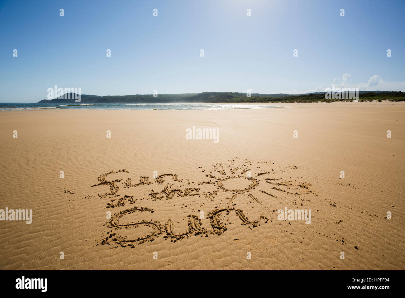 Fun in the sun written in sand at the beach, Croajingolong, Victoria, Australia - Stock Image