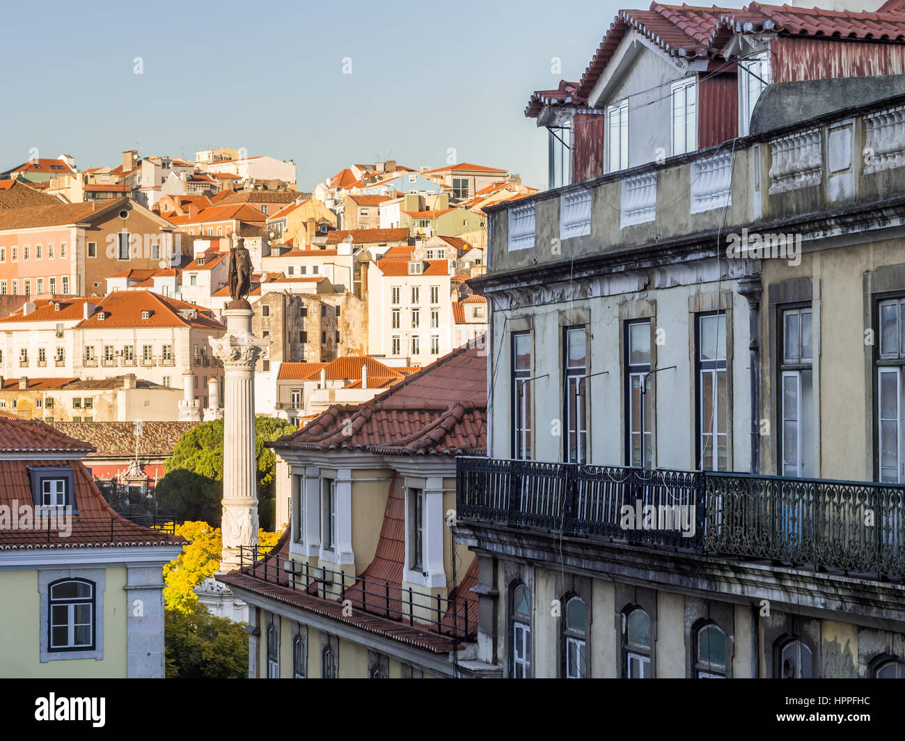 Column of Pedro IV on Rossio Square (Pedro IV Square) in Lisbon, Portugal with surrounding architecture. - Stock Image