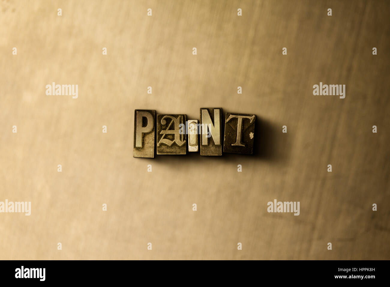 PAINT - close-up of grungy vintage typeset word on metal