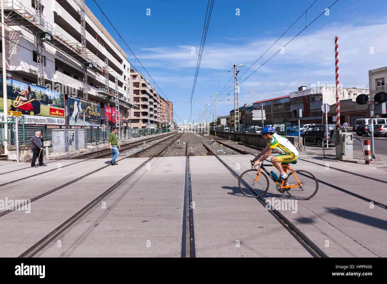 Cyclist  along a pedestrian railway crossing, Santurce or Santurtzi, Biscay,  Basque Country, Spain. - Stock Image