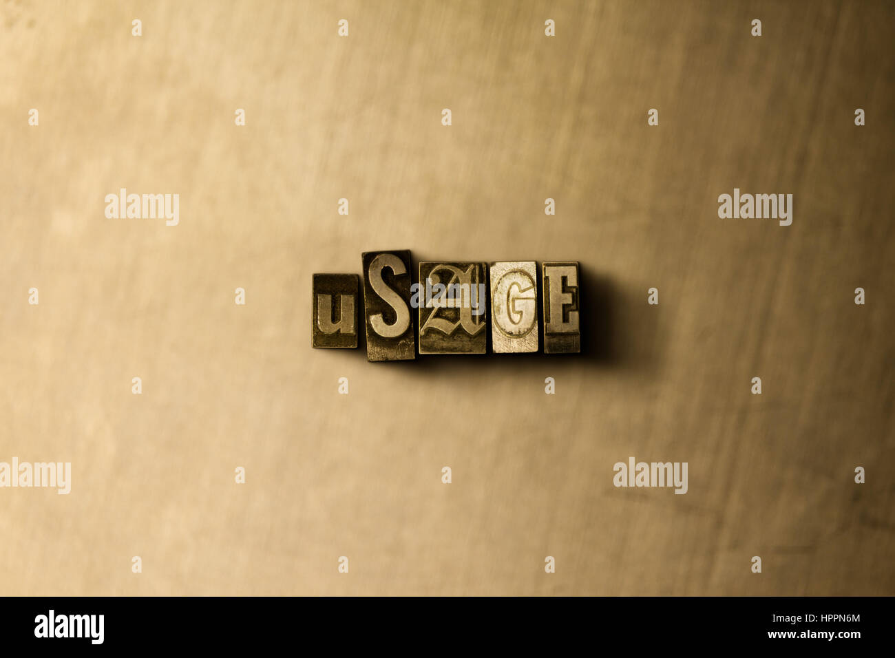 USAGE - close-up of grungy vintage typeset word on metal backdrop. Royalty free stock illustration.  Can be used - Stock Image