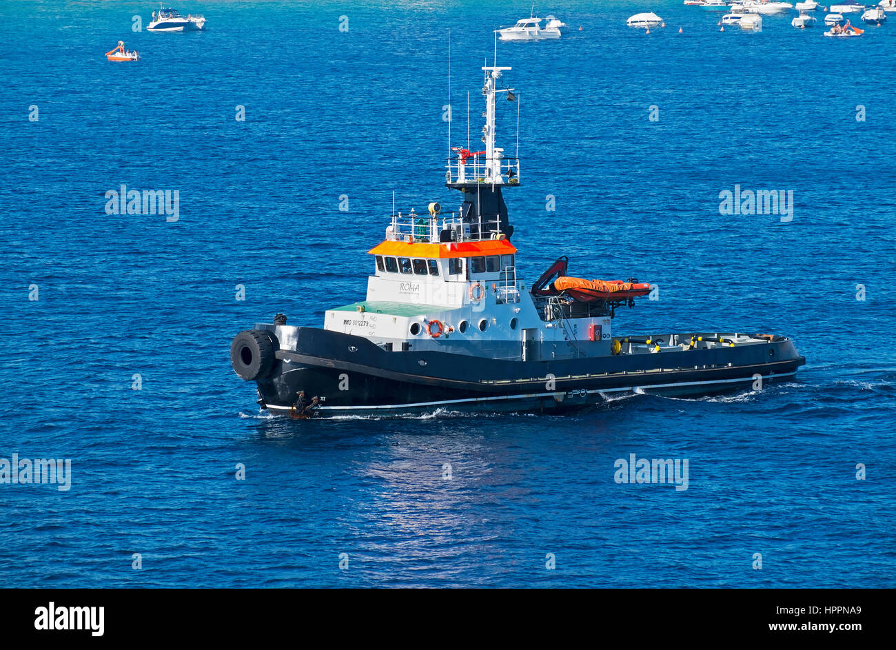 a tug boat in the mediterranean sea near the town of palamos in spain - Stock Image