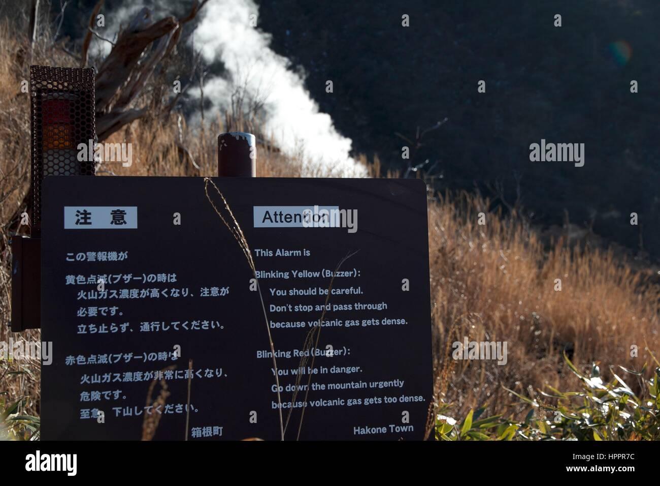 Volcanic gas warning sign and lights in Hakone, Japan, near Mount Fuji - Stock Image