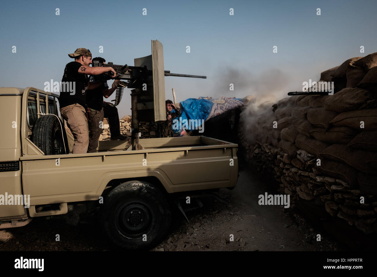Joshua and James Martinez engage Islamic State targets with a captured Browning 50 caliber Machine Gun from a fighting - Stock Image