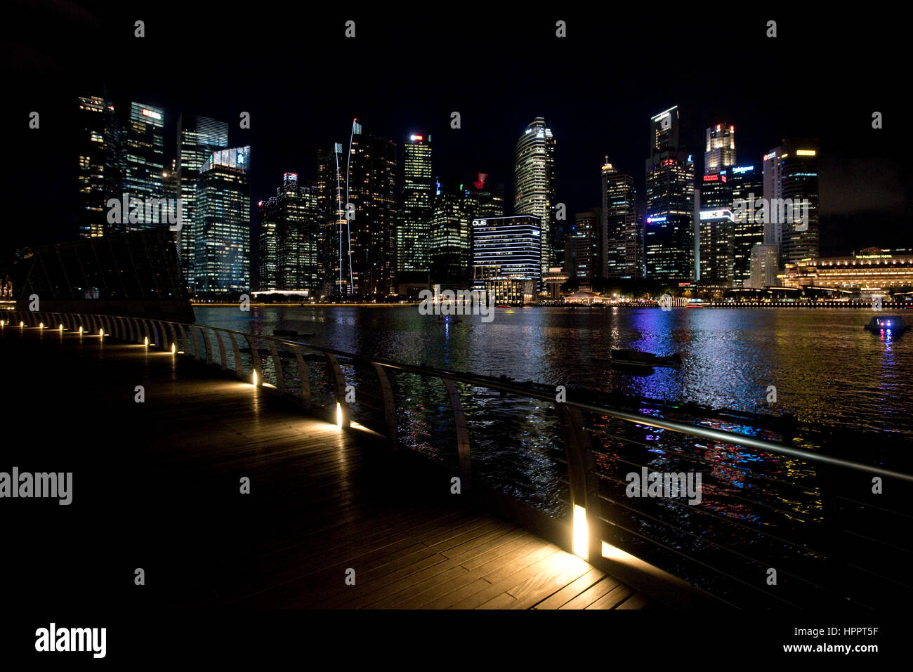 A cityscape view at night of the tower blocks and skyscrapers of the Central Business District (CBD) or Central - Stock Image