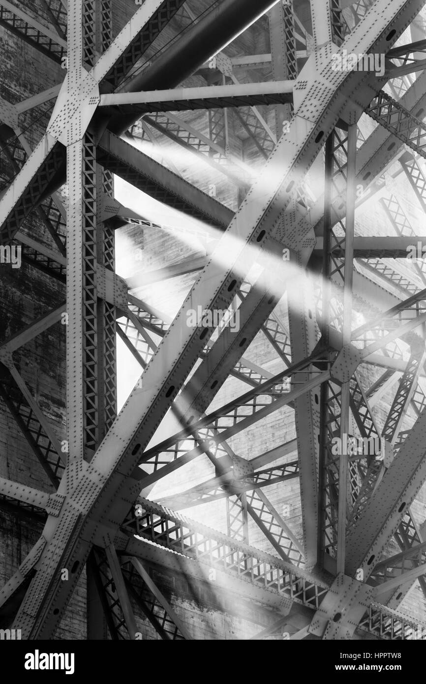 Shafts of light shine through the structure of the Golden Gate Bridge Stock Photo